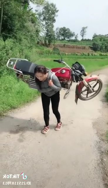 girl carried a motorbike when gas ran out
