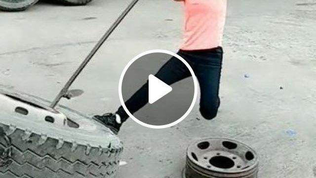 This Girl Removed Big Truck Tire Off Rim Is Faster Than Superman - Video & GIFs | Science & Technology, girl, remove tire, big truck tire, production, mechanic, household tools, human support machine