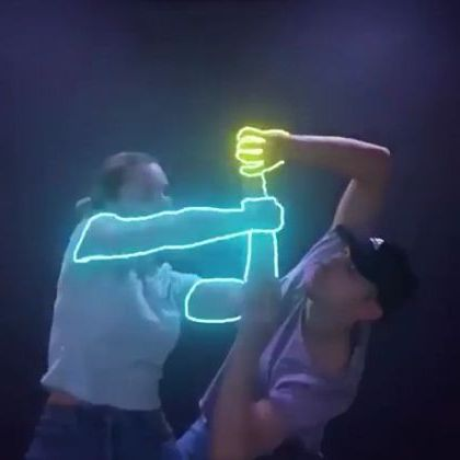 Artists dance with electronic devices and led lights