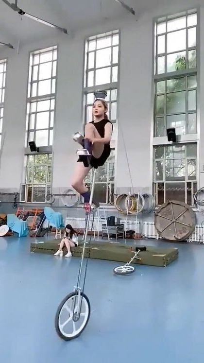 Girl is balancing on bicycle - Video & GIFs | sports,talented girls,sports bicycles,sportswear