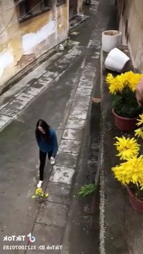 Girl and flower in Chinese street