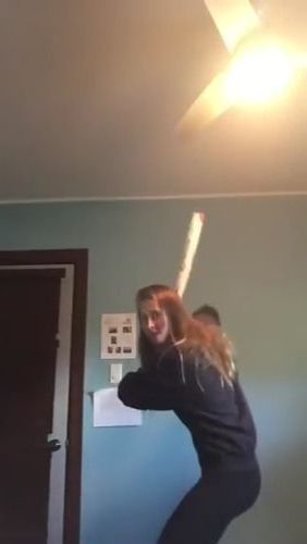 Girl practicing baseball in  living room - Funny Videos - funnylax.com - sports,girls,clothes fashion,baseball practice,living room,luxurious furniture,electrical equipment