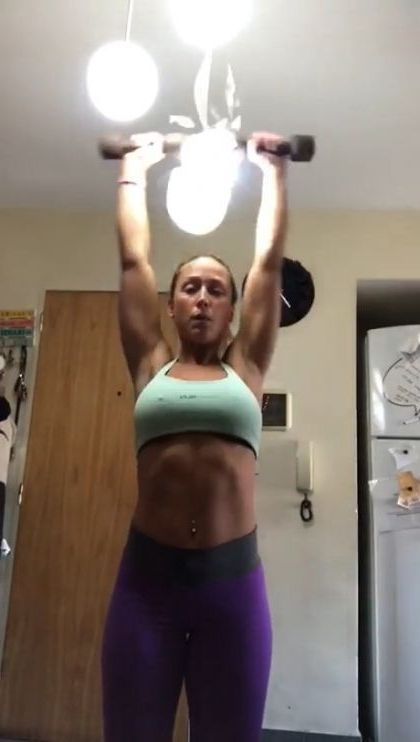 Girl practicing exercise in house