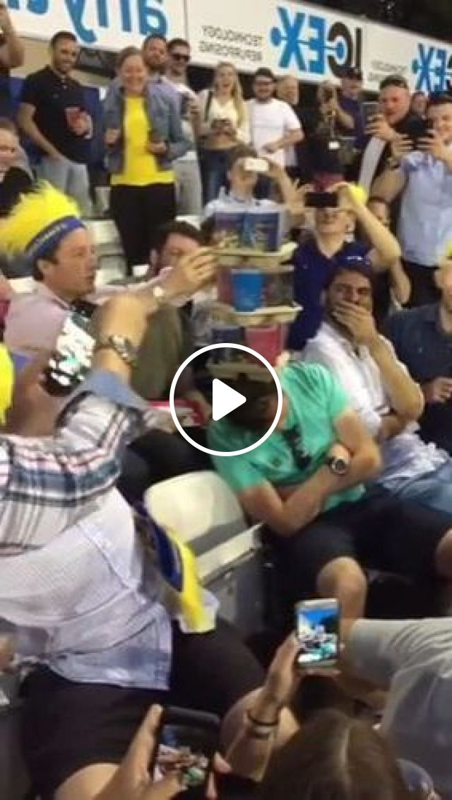People Are Filming A Man Holding Glass On His Head - Video & GIFs | Sports, camera, high definition, recording, audience, men and women fashion