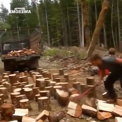 a man chopped wood with an ax, prepared to move onto truck and took it for sale