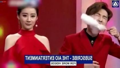 girl and boy eating sugar candy on TV