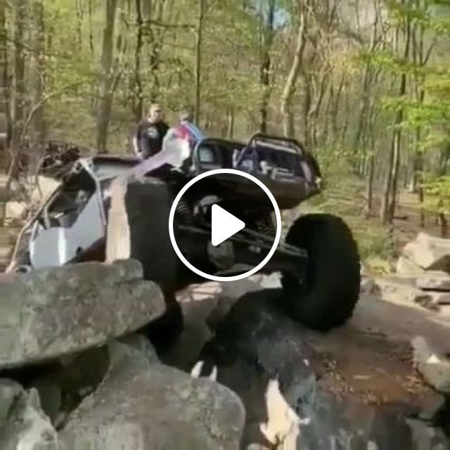 Man With Terrain Vehicle Crossing Rocks - Video & GIFs   auto & technique, men, male fashion, off-road vehicles, crossing stones