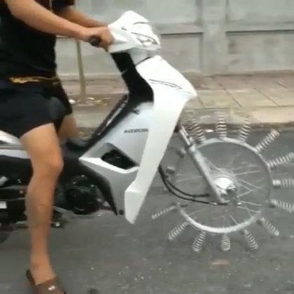 Motorcycle can run with  front wheels as springs - Funny Videos - funnylax.com - auto & technique,motorcycles,front wheels,springs,mechanical technology