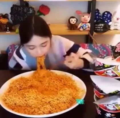 Girl can eat a lot of noodles in a restaurant